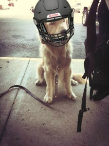 Burton wearing a football helmet