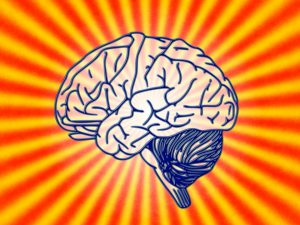 Image of cartoon brain surrounded by red and yellow lines connecting at centre behind brain.