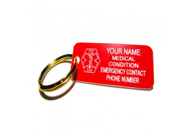 Red rectangular keychain sample with medical symbol offset to left. Engraving is in white.